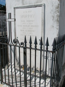Here lies Paul Morphy. Child prodigy and chess master. Chess players commonly leave chess pieces on his tomb as a sign of respect.
