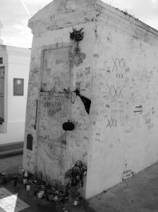 "Even though tourists make wishes, give objects, and mark ""XXX"" as some kind of voodoo ritual, it is still uncertain whether Marie Laveau is buried there."