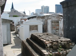 The aboveground tombs from St. Louis Cemetery #1 blend in well to the New Orleans skyline.