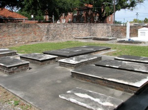 "The flat tombs are a stark contrast to the aboveground tombs in the ""Catholic"" section."