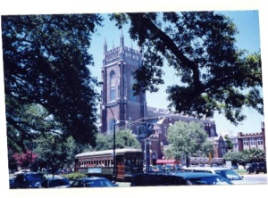 A streetcar rolls passed The Holy Name of Jesus Church on Loyola University's campus. Tulane University is adjacent to the church, and the beautiful Audubon Park is across the street.